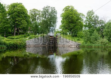 Beautiful summer view of a lock gate in Sweden taken from the water.