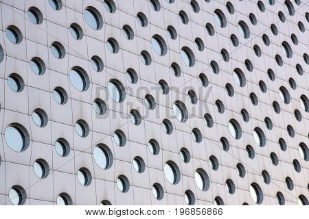 facade of a modern building with round windows