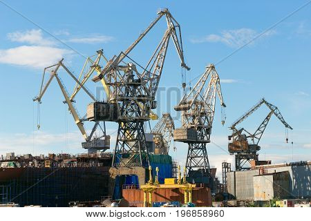 St. Petersburg Russia - 28 June 2017: port cranes operate on the Neva River in St. Petersburg