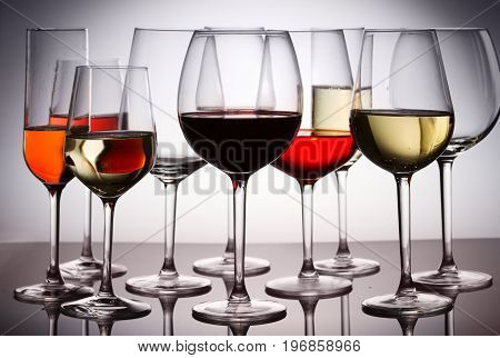 Set of party hight wine glasses with red, white and rose wine