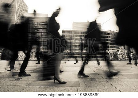 Business and office workers going to work in a fast blur during morning rush hour in Tokyo, Japan