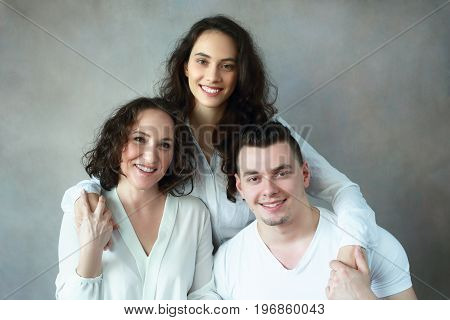 family headshot beautiful woman with grown up daughter and son