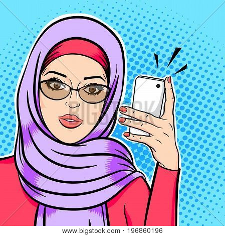 Beautiful muslim woman in hijab holding mobile phone reading sms or taking selfie concept vector in pop art comic retro style.