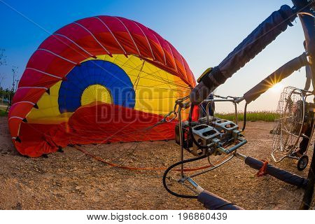 Starting filling hot air balloon burner before flight.
