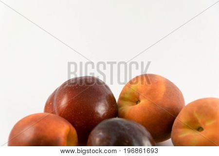 plums and peaches. Isolated on white background