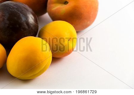 Plums, Peaches And Apricots On White Background