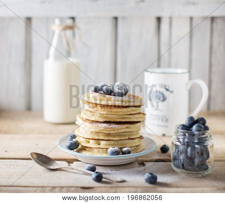Stack of pancakes with blueberry on a breakfast