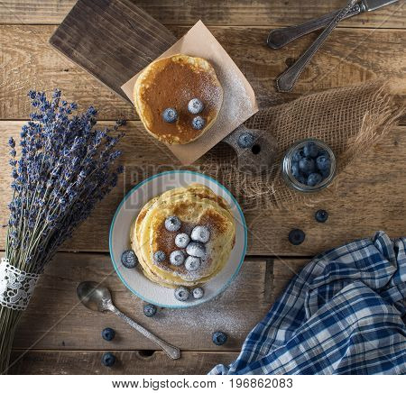 Some pancakes with blueberry on the wood table