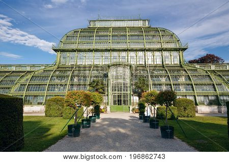 VIENNA/ AUSTRIA - JULY 8, 2017. The Palmenhaus Schoenbrunn - a large greenhouse opened in 1882 in the park Schoenbrunn in Vienna Austria