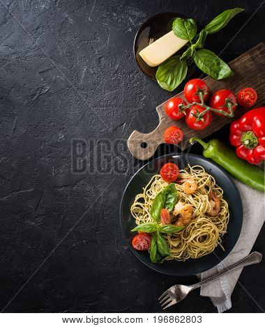whole grain spaghetti pasta with shrimps top view copy space
