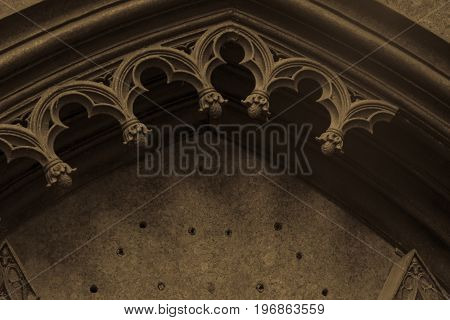 Vintage architecture photo. Old ruined gothic arch.