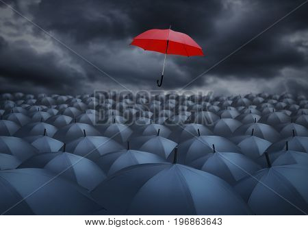 Being different concept with red umbrella outstanding from the others