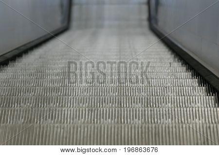 Escalator closeup in train station. background for graphic design.