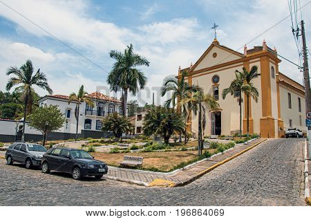Bananal, Brazil - January 21, 2015. Church facade in front of the square and cobblestone street in Bananal, a quiet and gracious inner city. Located in the São Paulo State, southwestern Brazil