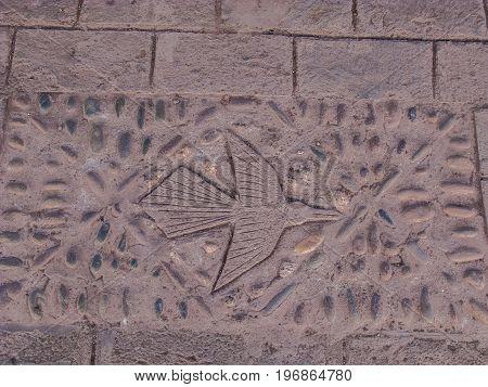Floor concrete condor symbol in the street Peru