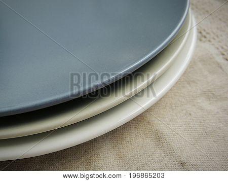 Matte plates on linen towel. Food photo props.