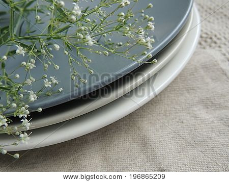 Summer flowers on matte plates. Beige linen towel. Food photo props.