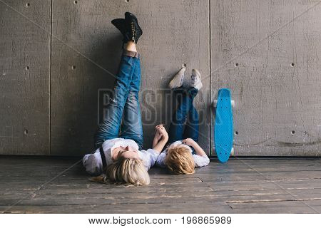 Young mother with son resting after skateboarding