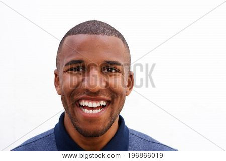 Close Up Laughing Young Black Guy On White Background