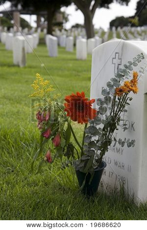 Flowers by a tombstone