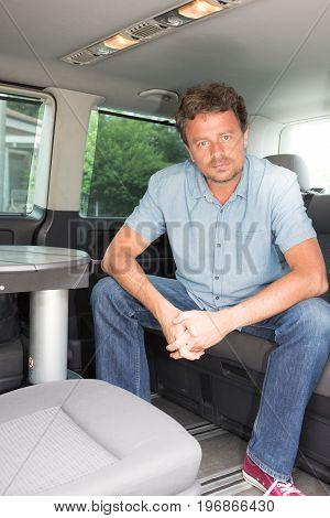 Confident Caucasian Male Forties Sitting In Car Van