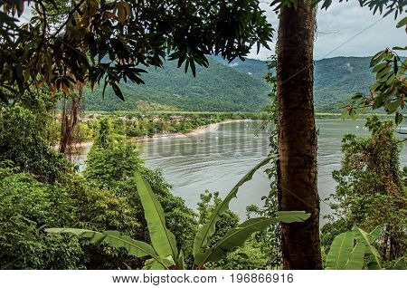 View of beach amidst tropical landscape on cloudy day near Paraty, an amazing and historic town totally preserved in the coast of the Rio de Janeiro State, southwestern Brazil