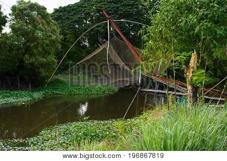 Fishnets in canal. Fishing equipment .Nature inThailand