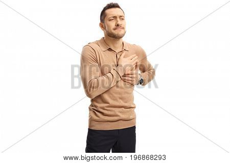 Young man having chest pain isolated on white background