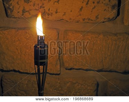 Bamboo Porch Torch On The Sandstone Wall Background In The Night