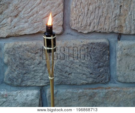 Bamboo Porch Torch On The Sandstone Wall Background