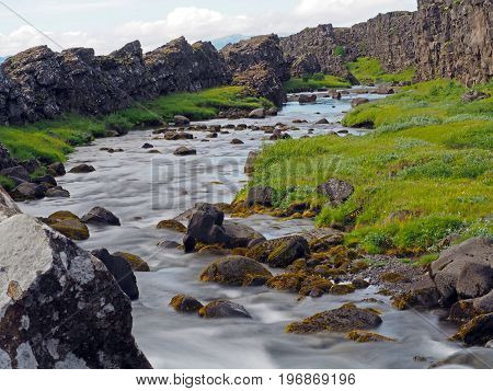 Melted  River In The Thingvellir National Park In Mid-atlantic Ridge