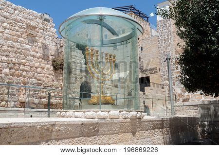 The Menorah - the golden seven-barrel lamp - the national and religious Jewish emblem near the Dung Gates in the Old City of Jerusalem Israel
