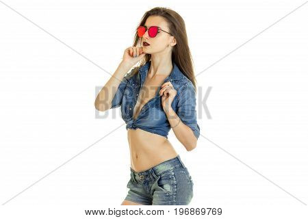 Young beautiful brunette woman in jeans clothes and sunglasses isolated on white background