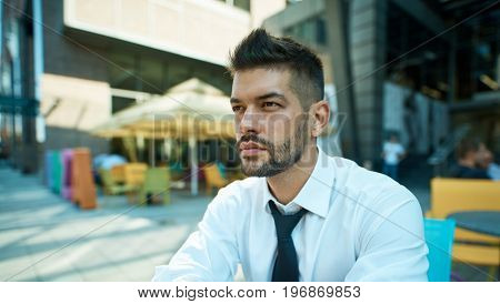 Portrait of dedicated businessman outdoors.