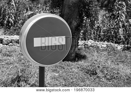 one road or street sign entrance is forbidden by a closeup of monochrome tone