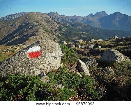 Mountain Trek - Granite Boulder Marked With Red And White