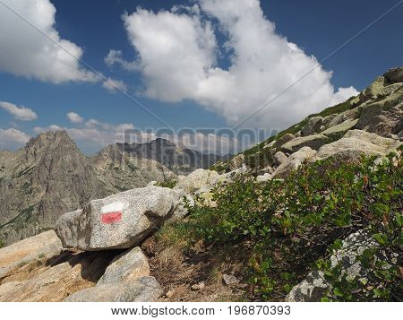 Mountain Trek Marked With Red And White