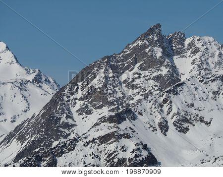 Alpine Mountain Peaks In Europe In Winter Snow