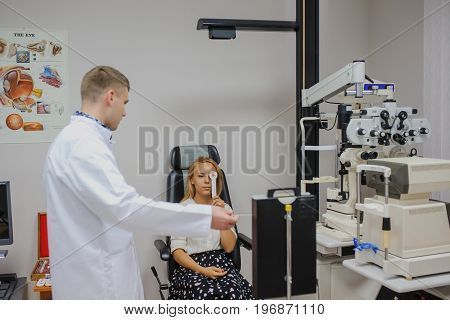 In An Ophthalmologic Clinic Dooing A Visual Test For Young Patient
