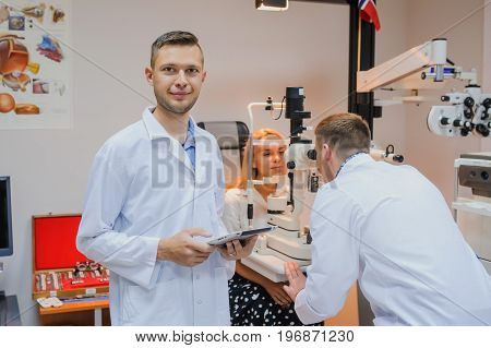 Portret Of Young Beautiful Doctor/eye Specialist/optometrist In An Ophthalmologic Clinic