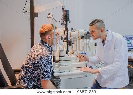 Young Beautiful Doctor/eye Specialist/optometrist In An Ophthalmologic Clinic