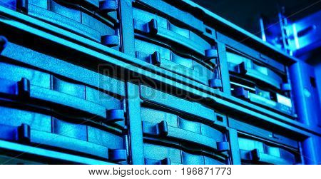 disk storage a closeup of a modern data center. blue toning