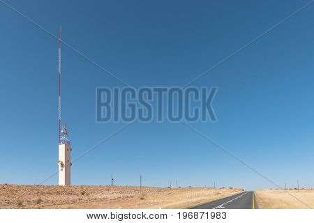 A microwave telcommunications tower and a cell phone tower near Kalkrand a village on the B1-road between Mariental and Rehoboth