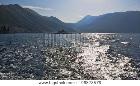 Mountains near the Bay of Kotor. View from the sea against sunlight