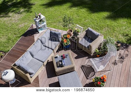 Shot of a cosy house terrace in a sunny day made from the bird view