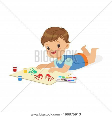 Happy smiling little boy lying on his stomach and painting with colorful handprints, a small artist, education and child development, colorful character vector Illustration