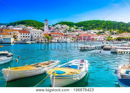 Seafront scenery of small mediterranean village Pucisca on Island Brac, tourist summer resort in Croatia, Europe.