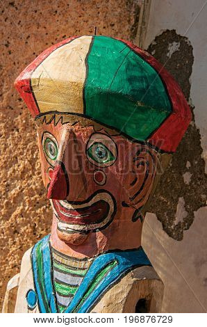 Close-up of colorful wooden puppet reminding a clown in Paraty, an amazing and historic town totally preserved in the coast of the Rio de Janeiro State, southwestern Brazil