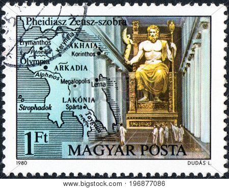 UKRAINE - CIRCA 2017: A postage stamp printed in Hungary shows Statue of Zeus in Olympia by Pheidias from series Seven Wonders of the Ancient World circa 1980