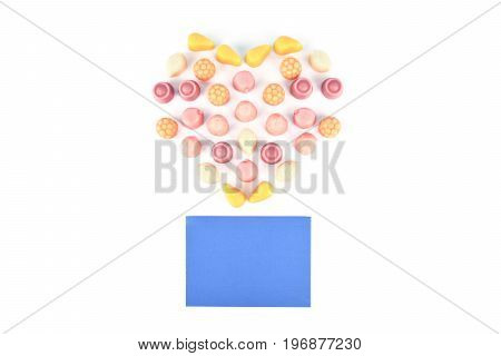 Jelly candies isolated on white background with a card and flower.